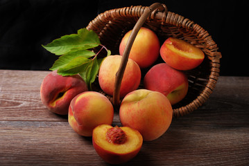 fresh peaches falling out of a basket