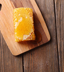 Fresh honeycomb on wooden table