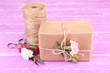 Obrazy na płótnie, fototapety, zdjęcia, fotoobrazy drukowane : Beautiful gift with flowers and decorative rope,