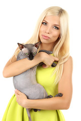 Beautiful young woman holding gray sphinx cat isolated on white