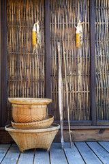 thai bamboo basket hand craft with wood wall  rural home scene i