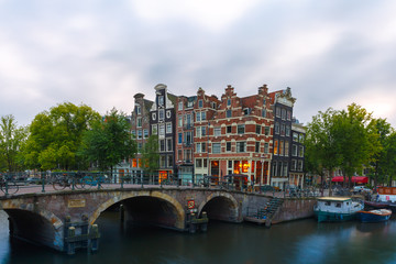 Dusk city view of Amsterdam canal and bridge