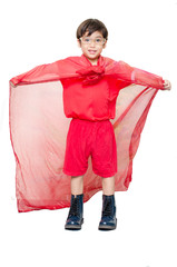 little boy is dressed up as a superhero flying
