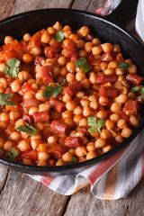Chickpeas with meat in tomato sauce in the pan vertical
