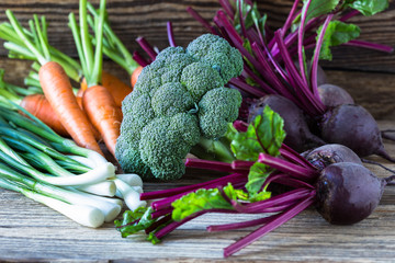 Fresh vegetables carrots, beetroots, broccoli, green onion on  w