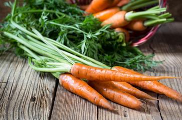 Fresh vegetables carrot on  wooden background