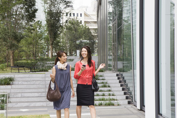 Modern office building、Two young women
