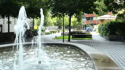 Fountain -park with benches, tress and people