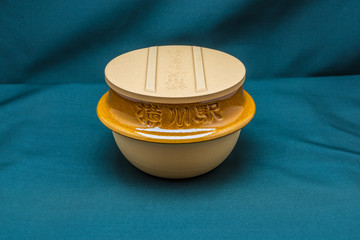 Japanese clay bowl with cover in back view