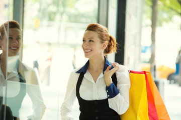 Happy smiling attractive woman shopping in new york city mall