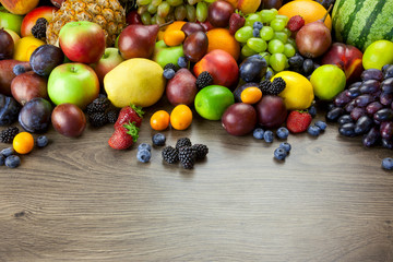 Big assortment of Fresh Organic Fruits, frame composition on woo