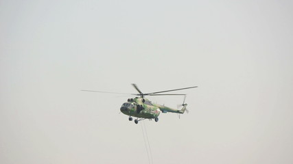 Military helicopter flying by
