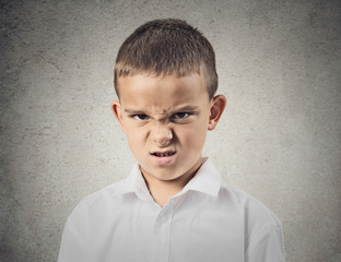 Portrait angry disgusted boy isolated on grey wall background