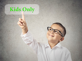 Portrait Boy Pushing Kids Only Button, grey wall background