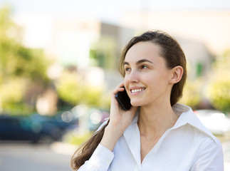 Portrait Happy young woman talking on mobile phone