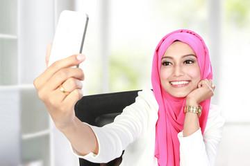 young beautiful woman taking selfie