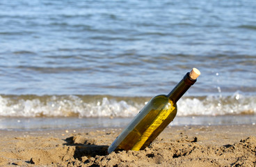 secret message in bottle on the seashore