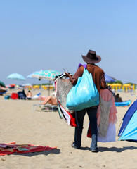 peddler of clothes on the beach of the sea i