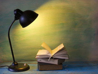 open book with vintage lamp, free copy space