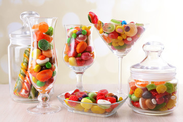 Different colorful fruit candy in glasses