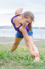 Young woman stretches before doing sports.