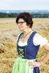 Portrait of woman in Dirndl on the field