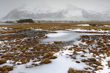 View on an Icelandic landscape with frozen tundra.