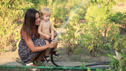 Woman with baby watered