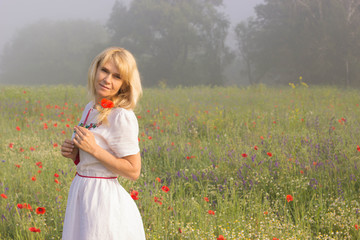 a woman climbed in poppies