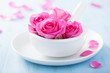 pink rose flowers in mortar for aromatherapy and spa