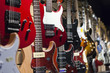 Many electric guitars hanging on wall in the shop. - 68793386