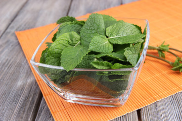 Glass square bowl of mint leaves