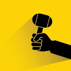 hand holding lump hammer