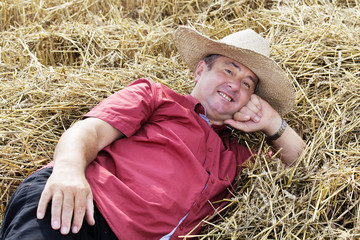 man who is down on straw and takes a rest