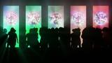 Club dancing crowd silhouettes.