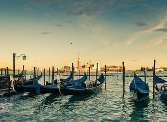 Gondolas moored by Saint Mark square with San Giorgio di Maggior