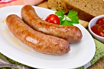 Sausages pork fried in plate on board
