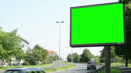 billboard - green screen - urban street with passing cars