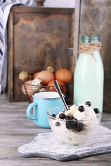 Dairy products and fresh eggs  on wooden background