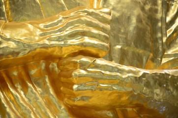 Golden hand Buddha statue