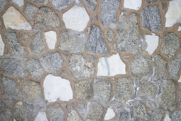 Irregular grey stone wall background