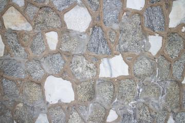 Irregular grey stone wall background