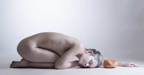 Beautiful yogi with closed eyes posing naked