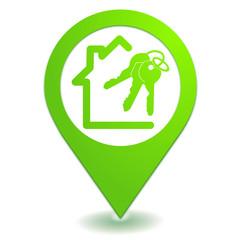 maison immobilier sur symbole localisation vert