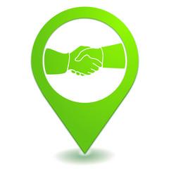 poignée de main sur symbole localisation vert
