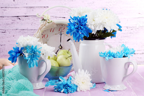 canvas print picture Composition of white and blue chrysanthemum and utensil