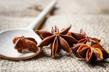 Star anise, wooden spoon