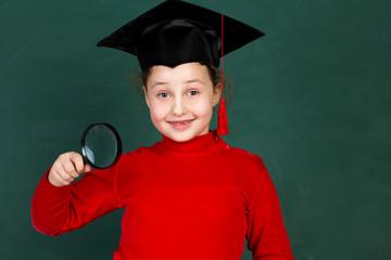 joyful girl with magnifying glass