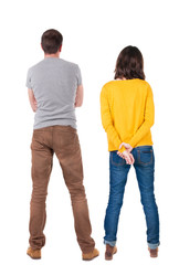 Back view of young couple  hug and look into the distance..