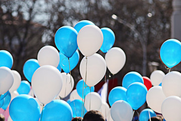 Blue and white balloons crowd